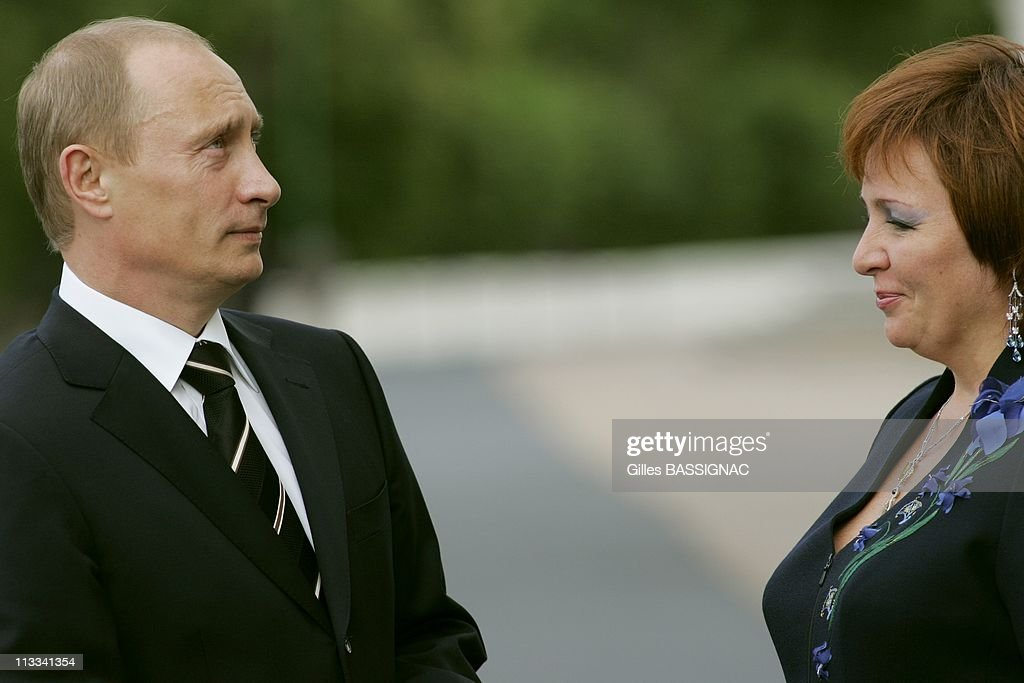 Arrival Of G8 Leaders And Their Spouses For An Informal Dinner At Panderhoff Palace, During The Saint-Pandersburg G8 Summit - On July 15Th, 2006 - In Saint Pandersbourg, Russia - Here, Russian Federation President <a gi-track='captionPersonalityLinkClicked' href=/galleries/search?phrase=Vladimir+Putin&family=editorial&specificpeople=154896 ng-click='$event.stopPropagation()'>Vladimir Putin</a> And His Wife Liudmila Putin