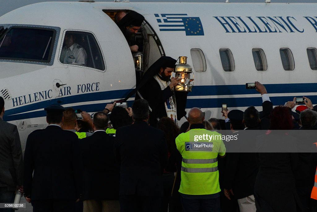Arrival of the holy Easter Light with the governmental airplane at Eleftherios Venizelos Airport. The light comes from Jerusalem and is honored at arrival as a President of State. In Athens/East Attica, on April 30, 2016