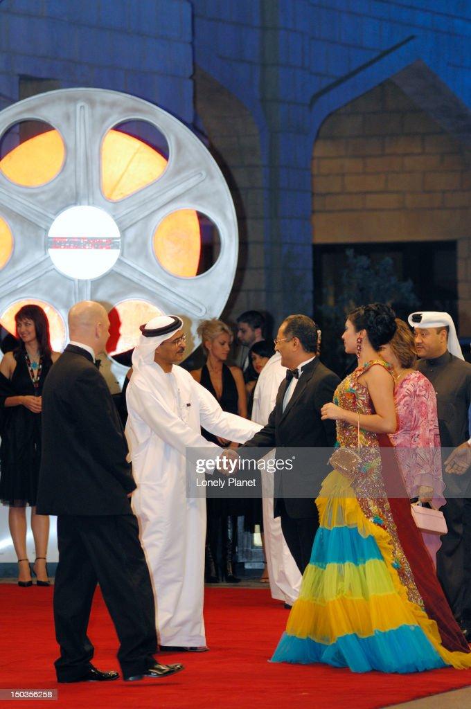 Arrivals on red carpet, Dubai International Film Festival (DIFF) opening.