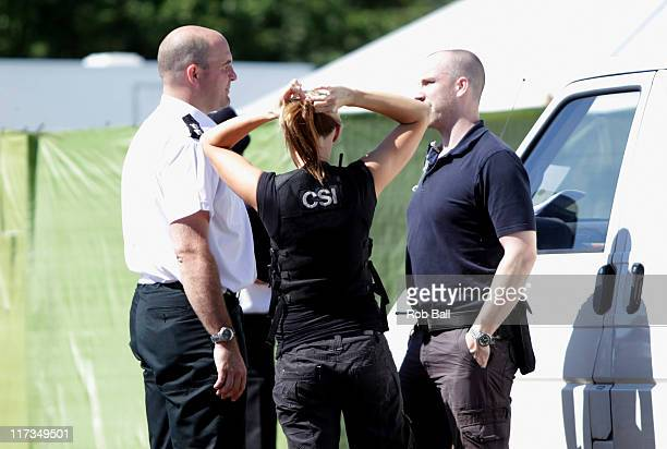 CSI arrive as police corner off an area of the VIP area at Glastonbury Festival on June 26 2011 in Glastonbury England Somerset and Avon Police are...