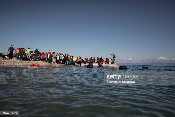Arrived on the shores of Lesbos near Mytilene airport refugees from Afghanistan and Syria wait to disembark their rubber boat under guidance of...