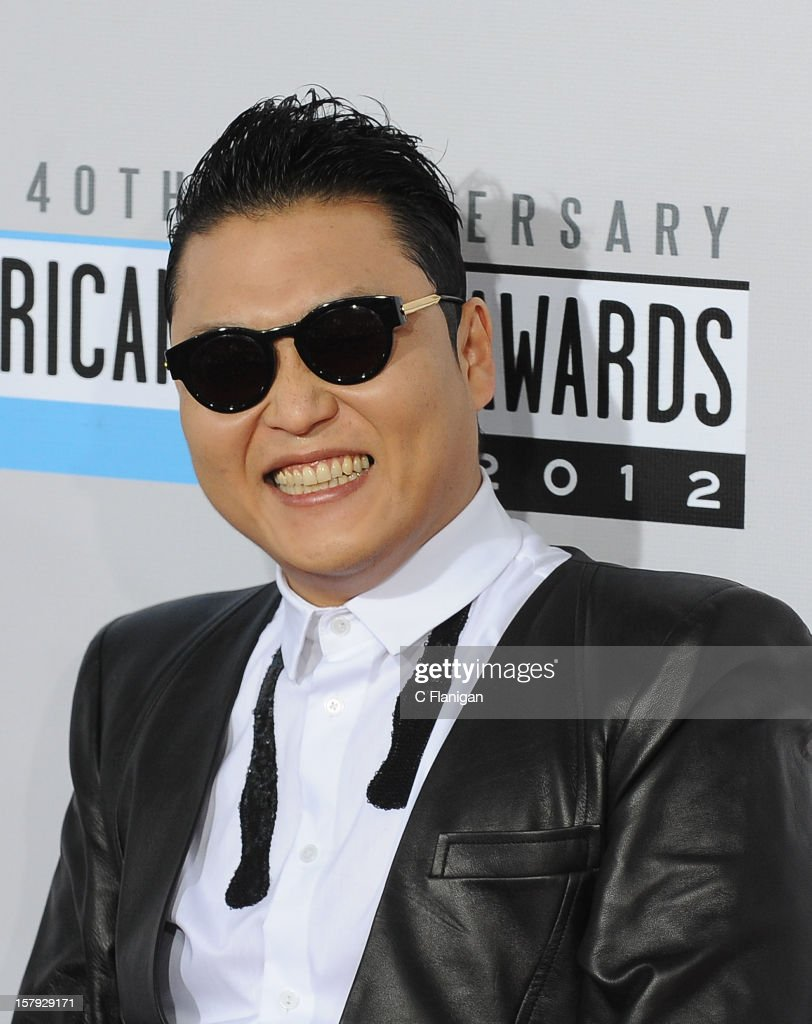 PSY arrives at The 40th American Music Awards at Nokia Theatre L.A. Live on November 18, 2012 in Los Angeles, California.