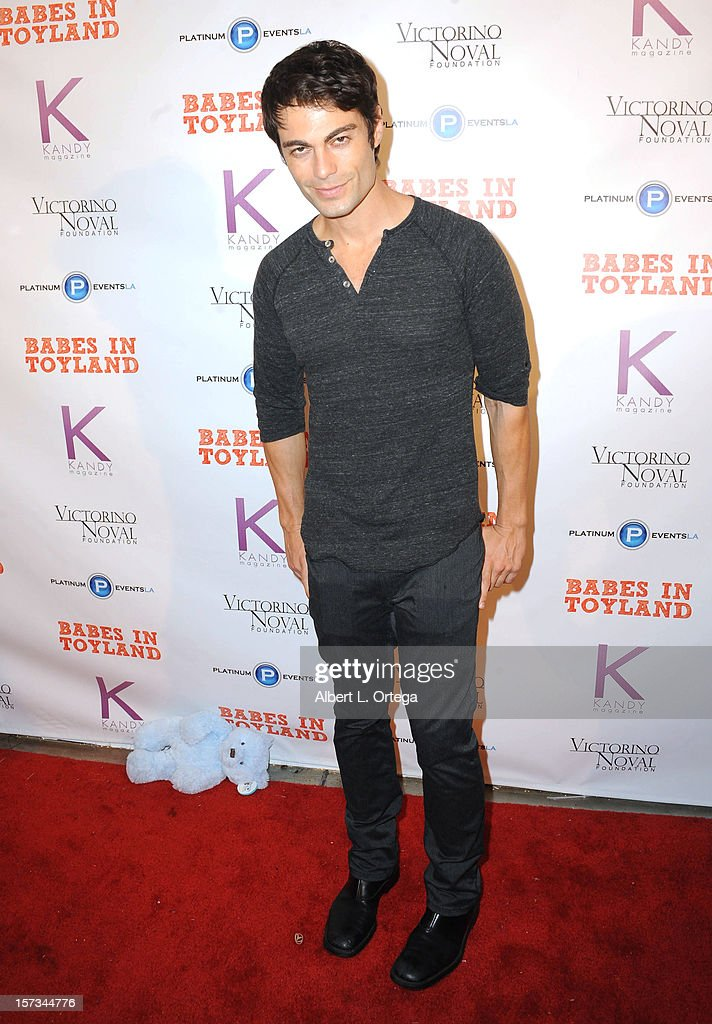 arrives for the 5th Annual Babes In Toyland Charity Toy Drive to benefit Los Angeles County Sheriff's Department Toy Drive held at Confidential on December 1, 2012 in Beverly Hills, California.