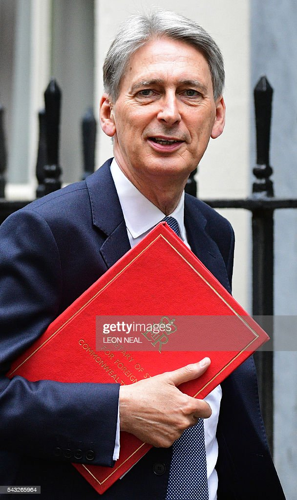 arrives to attend a cabinet meeting at 10 Downing Street in central London on June 27, 2016. European stock markets mostly slid Monday as British finance minister George Osborne attempted to calm jitters after last week's shock Brexit referendum. Britain's surprise referendum decision to leave the European Union wiped $2.1 trillion off market valuations on Friday and sent the pound collapsing to a 31-year low against the dollar. / AFP / LEON