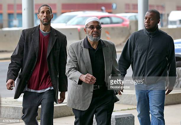 Arriving at Boston Police Headquarters in Boston left to right are friend of the family Mu'alim Abdullah Boston Muslim leader and Imam Abdullah...