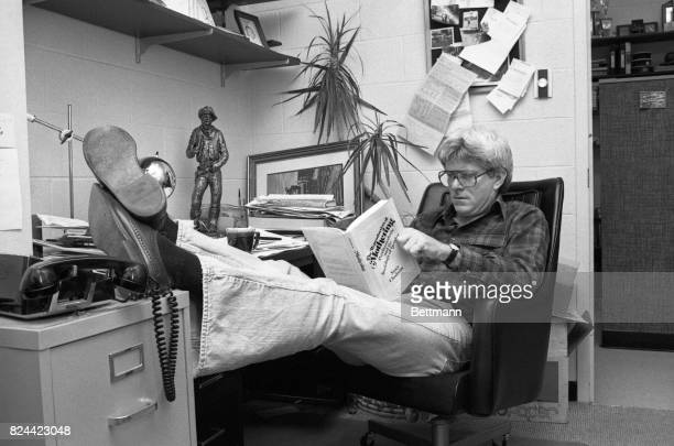 Arriving in his cinderblock studio at WGNTV Phil Donahue bones up for his morning program with a book by the author who will be on his show Nancy...