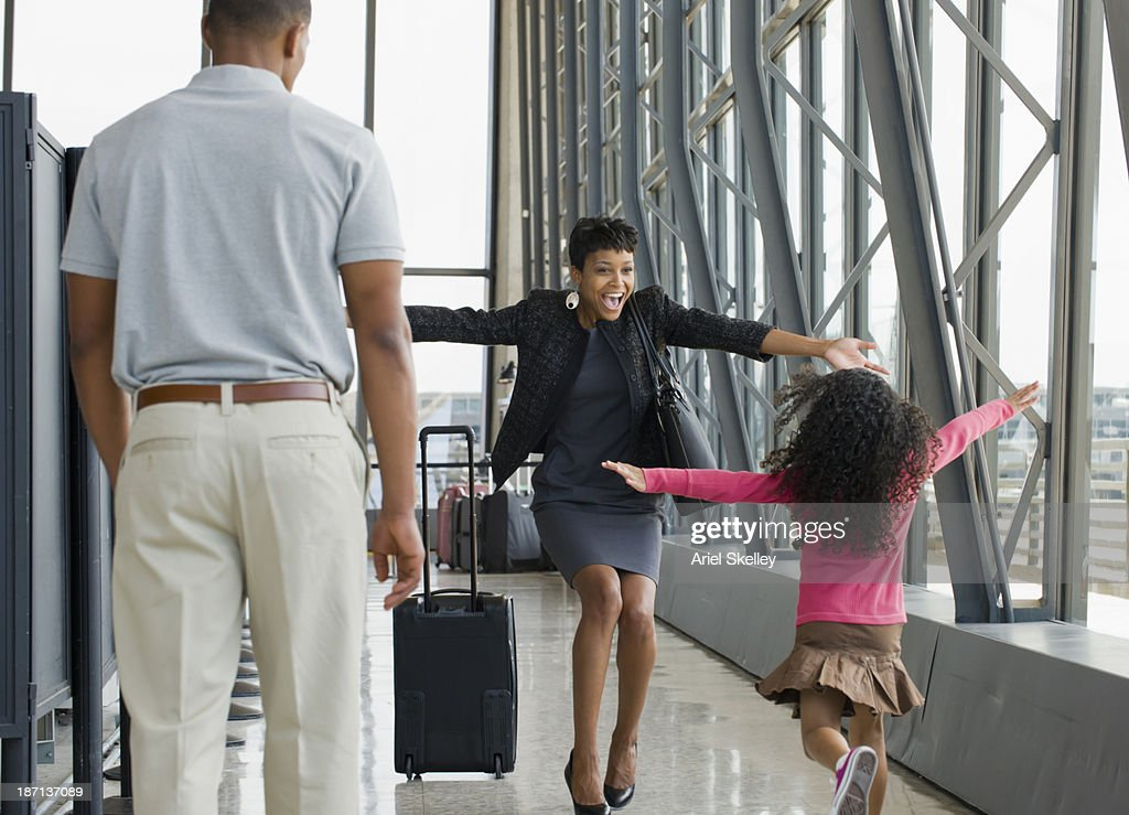 Arriving mother greeting daughter in airport