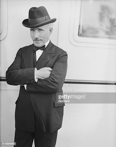 Arriving on the SS Bremen Arturo Toscanini famous orchestra conductor is shown above on board the SS Bremen when it landed at New York where he again...