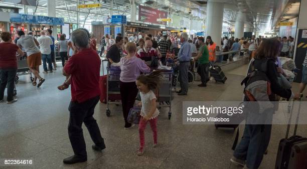 Arriving passengers crowd arrivals hall in Terminal 1 of the Humberto Delgado International Airport on July 25 2017 in Lisbon Portugal The Portuguese...