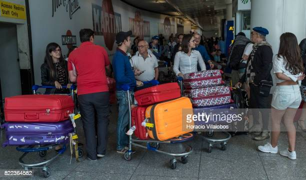 Arriving passengers crowd Terminal 1 of the Humberto Delgado International Airport on July 25 2017 in Lisbon Portugal The Portuguese tourist industry...