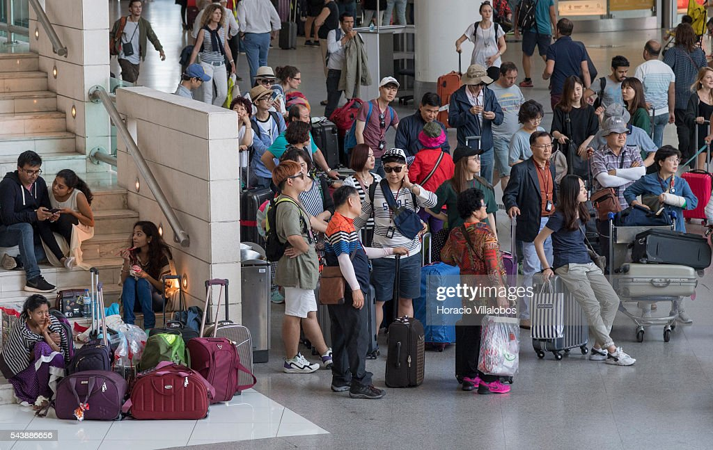 Arriving passengers in Terminal 1 of Lisbon Humberto Delgado Airport in a business as usual day after air controllers called off their strike action on June 30, 2016 in Lisbon, Portugal. Although controllers cancelled their labor protest, the airport will suffer a three-days strike, starting on July 1st, staged by luggage handlers, that is supposed to cause a grave disruption.