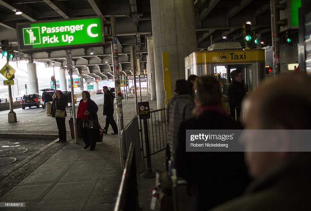 Arriving passengers wait in line for taxis February 3, 2013 at the John F Kennedy International Airport in the Queens borough of New York.