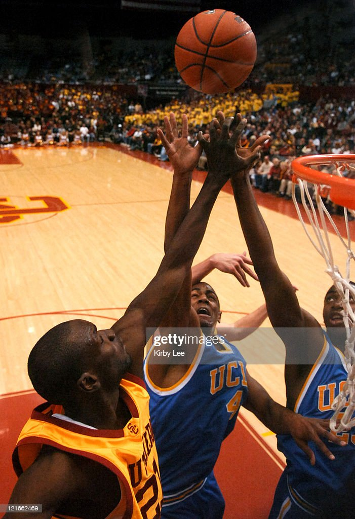 <a gi-track='captionPersonalityLinkClicked' href=/galleries/search?phrase=Arron+Afflalo&family=editorial&specificpeople=640861 ng-click='$event.stopPropagation()'>Arron Afflalo</a> (center) and Luc Richard Mbah a Moute (right) of UCLA battle Abdoulaye Ndiaye of USC for rebound during Pacific-10 Conference basketball game at the Los Angeles Memorial Sports Arena on Sunday, February 19, 2006.