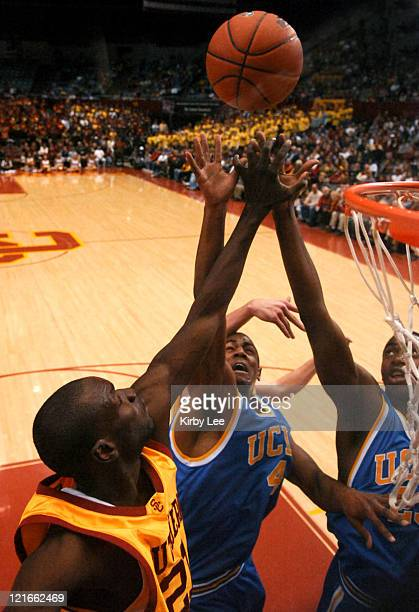 Arron Afflalo and Luc Richard Mbah a Moute of UCLA battle Abdoulaye Ndiaye of USC for rebound during Pacific10 Conference basketball game at the Los...