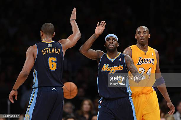 Arron Afflalo and Ty Lawson of the Denver Nuggets react in the first half alongside Kobe Bryant of the Los Angeles Lakers in Game Seven of the...