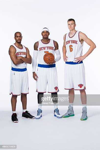 Arron Afflalo Carmelo Anthony and Kristaps Porzingis of the New York Knicks pose for a portrait at Media Day at the MSG Training Facility in...