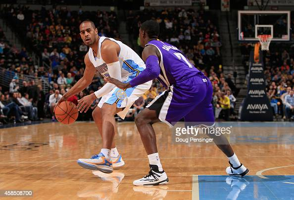 Arron Afflalo of the Denver Nuggets controls the ball against Darren Collison of the Sacramento Kings at Pepsi Center on November 3 2014 in Denver...