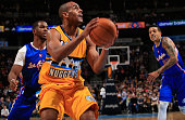 Arron Afflalo of the Denver Nuggets controls the ball against the Los Angeles Clippers at Pepsi Center on December 19 2014 in Denver Colorado The...