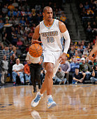 Arron Afflalo of the Denver Nuggets controls the ball against the Orlando Magic at Pepsi Center on January 7 2015 in Denver Colorado The Nuggets...