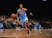 Arron Afflalo of the Denver Nuggets dribbles the ball against the Brooklyn Nets on December 23 2014 at the Barclays Center in Brooklyn NY NOTE TO...