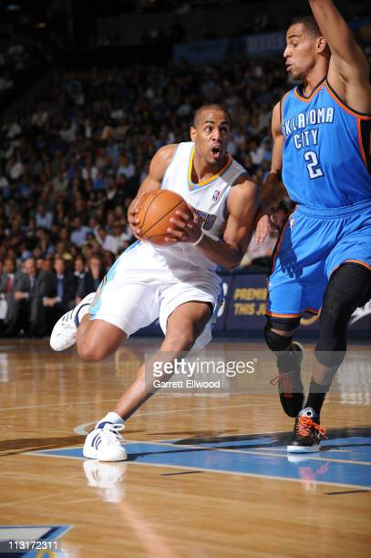 Arron Afflalo of the Denver Nuggets drives to the basket against Thabo Sefolosha of the Oklahoma City Thunder in Game Four of the Western Conference...