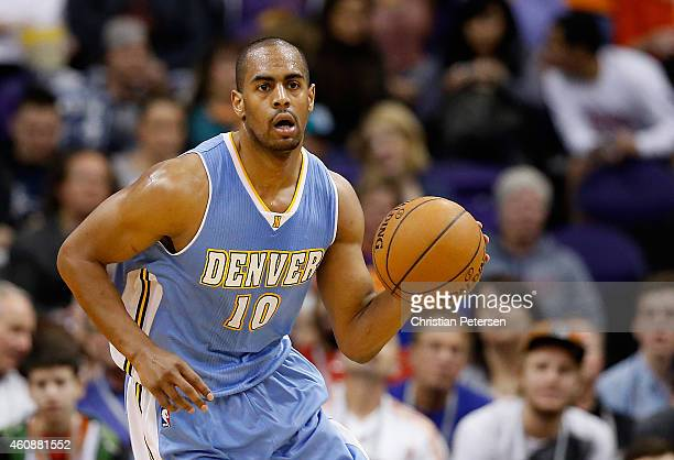 Arron Afflalo of the Denver Nuggets handles the ball during the NBA game against the Phoenix Suns at US Airways Center on November 26 2014 in Phoenix...
