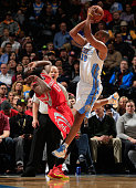 Arron Afflalo of the Denver Nuggets is called for an offensive foul against James Harden of the Houston Rockets by referee Joe Crawford at Pepsi...