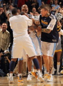 Arron Afflalo of the Denver Nuggets is congratulated by teammates Gary Forbes JR Smith and Chris Andersen after he scored the game winning basket...