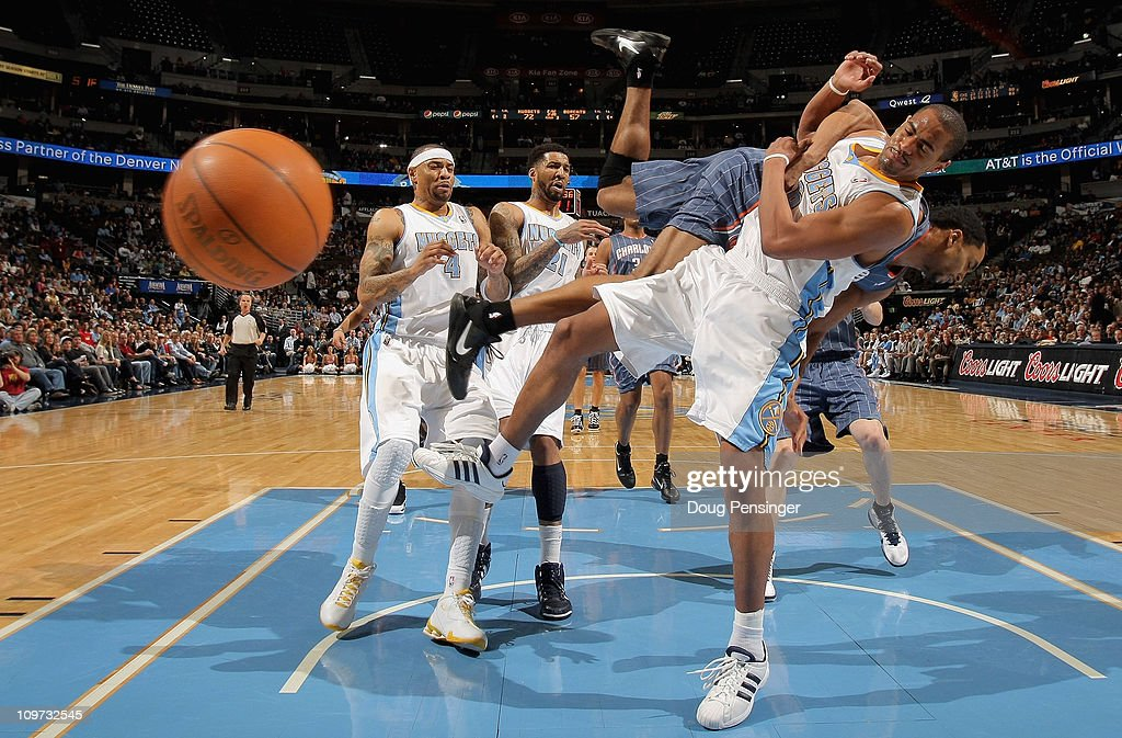 <a gi-track='captionPersonalityLinkClicked' href=/galleries/search?phrase=Arron+Afflalo&family=editorial&specificpeople=640861 ng-click='$event.stopPropagation()'>Arron Afflalo</a> #6 of the Denver Nuggets is fouled by Gerald Henderson #15 of the Charlotte Bobcats as he tries to layup a shot at the Pepsi Center on March 2, 2011 in Denver, Colorado. The Nuggets defeated the Bobcats 120-80.NOTE