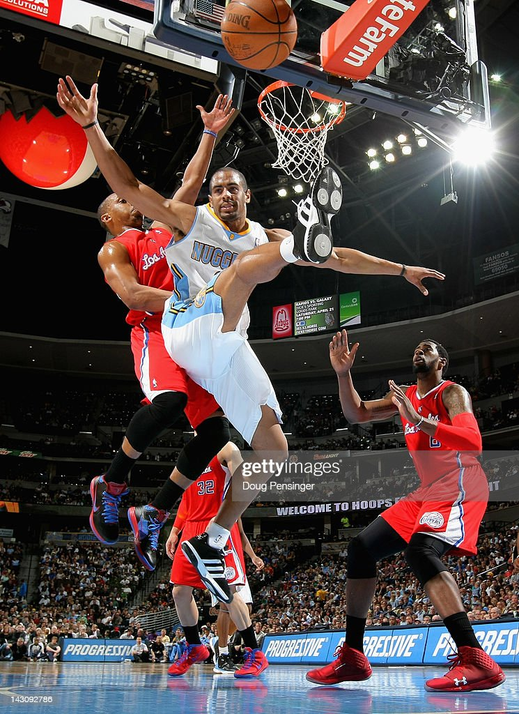 <a gi-track='captionPersonalityLinkClicked' href=/galleries/search?phrase=Arron+Afflalo&family=editorial&specificpeople=640861 ng-click='$event.stopPropagation()'>Arron Afflalo</a> #6 of the Denver Nuggets looses control of the ball against <a gi-track='captionPersonalityLinkClicked' href=/galleries/search?phrase=Randy+Foye&family=editorial&specificpeople=240185 ng-click='$event.stopPropagation()'>Randy Foye</a> #4 of the Los Angeles Clippers at Pepsi Center on April 18, 2012 in Denver, Colorado. The Clippers defeated the Nuggets 104-98.