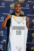 Arron Afflalo of the Denver Nuggets poses for a photo during a press conference on June 30 2014 at the Pepsi Center in Denver Colorado NOTE TO USER...