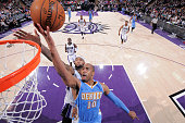 Arron Afflalo of the Denver Nuggets shoots a layup against DeMarcus Cousins of the Sacramento Kings on January 9 2015 at Sleep Train Arena in...