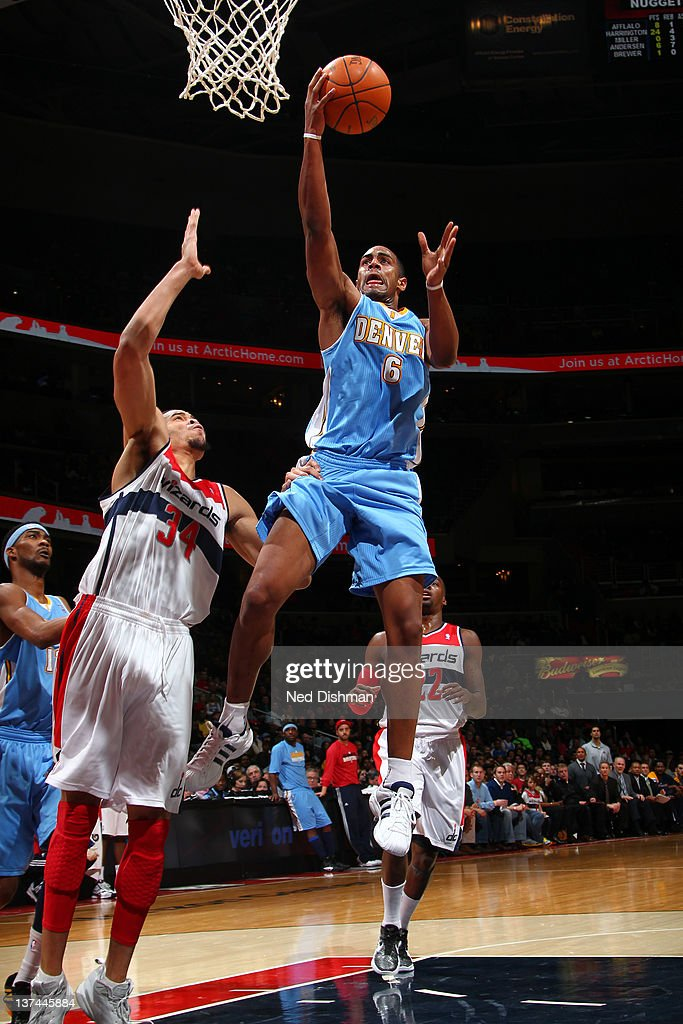 <a gi-track='captionPersonalityLinkClicked' href=/galleries/search?phrase=Arron+Afflalo&family=editorial&specificpeople=640861 ng-click='$event.stopPropagation()'>Arron Afflalo</a> #6 of the Denver Nuggets shoots against <a gi-track='captionPersonalityLinkClicked' href=/galleries/search?phrase=JaVale+McGee&family=editorial&specificpeople=4195625 ng-click='$event.stopPropagation()'>JaVale McGee</a> #34 of the Washington Wizards during the game at the Verizon Center on January 20, 2012 in Washington, DC.