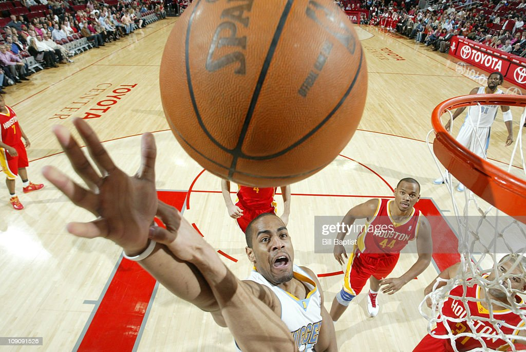 <a gi-track='captionPersonalityLinkClicked' href=/galleries/search?phrase=Arron+Afflalo&family=editorial&specificpeople=640861 ng-click='$event.stopPropagation()'>Arron Afflalo</a> #6 of the Denver Nuggets shoots the ball over <a gi-track='captionPersonalityLinkClicked' href=/galleries/search?phrase=Chuck+Hayes&family=editorial&specificpeople=206129 ng-click='$event.stopPropagation()'>Chuck Hayes</a> #44 of the Houston Rockets on February 14, 2011 at the Toyota Center in Houston, Texas.