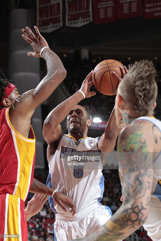 <a gi-track='captionPersonalityLinkClicked' href=/galleries/search?phrase=Arron+Afflalo&family=editorial&specificpeople=640861 ng-click='$event.stopPropagation()'>Arron Afflalo</a> #6 of the Denver Nuggets shoots the ball over <a gi-track='captionPersonalityLinkClicked' href=/galleries/search?phrase=Jordan+Hill+-+Giocatore+di+basket&family=editorial&specificpeople=13503530 ng-click='$event.stopPropagation()'>Jordan Hill</a> #27 of the Houston Rockets on February 14, 2011 at the Toyota Center in Houston, Texas.
