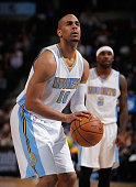 Arron Afflalo of the Denver Nuggets takes a free throw against the San Antonio Spurs at Pepsi Center on January 20 2015 in Denver Colorado The Spurs...