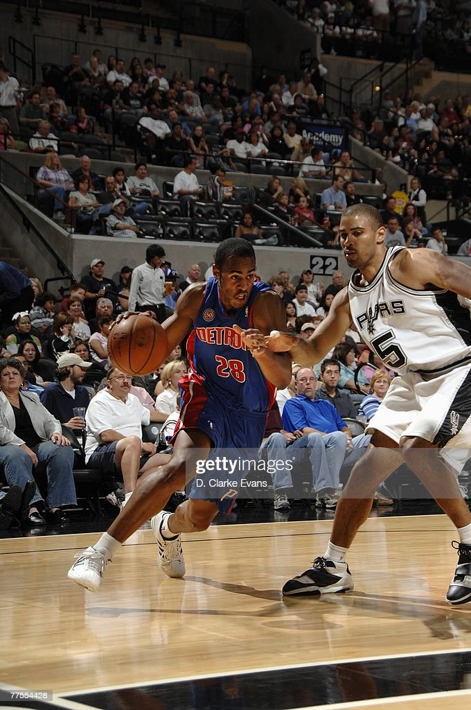 Arron Afflalo #28 of the Detroit Pistons drives to the basket against Ime Udoka #5 of the San Antonio Spurs during a preseason game at AT&T Center on October 20, 2007 in San Antonio, Texas. The Spurs won 104-80.