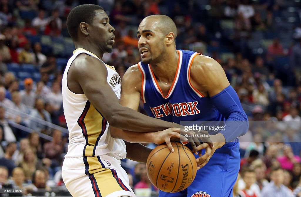 Arron Afflalo of the New York Knicks and Jrue Holiday of the New Orleans Pelicans fight for a loose ball during the second half at the Smoothie King...