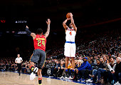 Arron Afflalo of the New York Knicks shoots against Kent Bazemore of the Atlanta Hawks during the game on January 3 2016 at Madison Square Garden in...