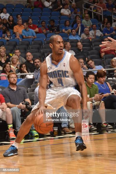 Arron Afflalo of the Orlando Magic dribbles the ball against the Cleveland Cavaliers during the game on April 2 2014 at Amway Center in Orlando...