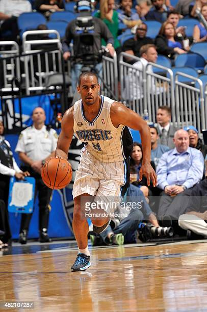 Arron Afflalo of the Orlando Magic dribbles up the court against the Cleveland Cavaliers during the game on April 2 2014 at Amway Center in Orlando...