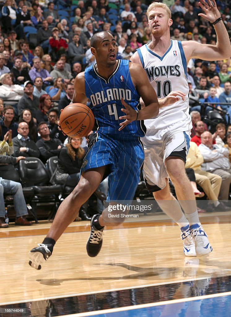Arron Afflalo #4 of the Orlando Magic drives against Chase Budinger #10 of the Minnesota Timberwolves during the game between the Minnesota Timberwolves and the Orlando Magic on November 7, 2012 at Target Center in Minneapolis, Minnesota.