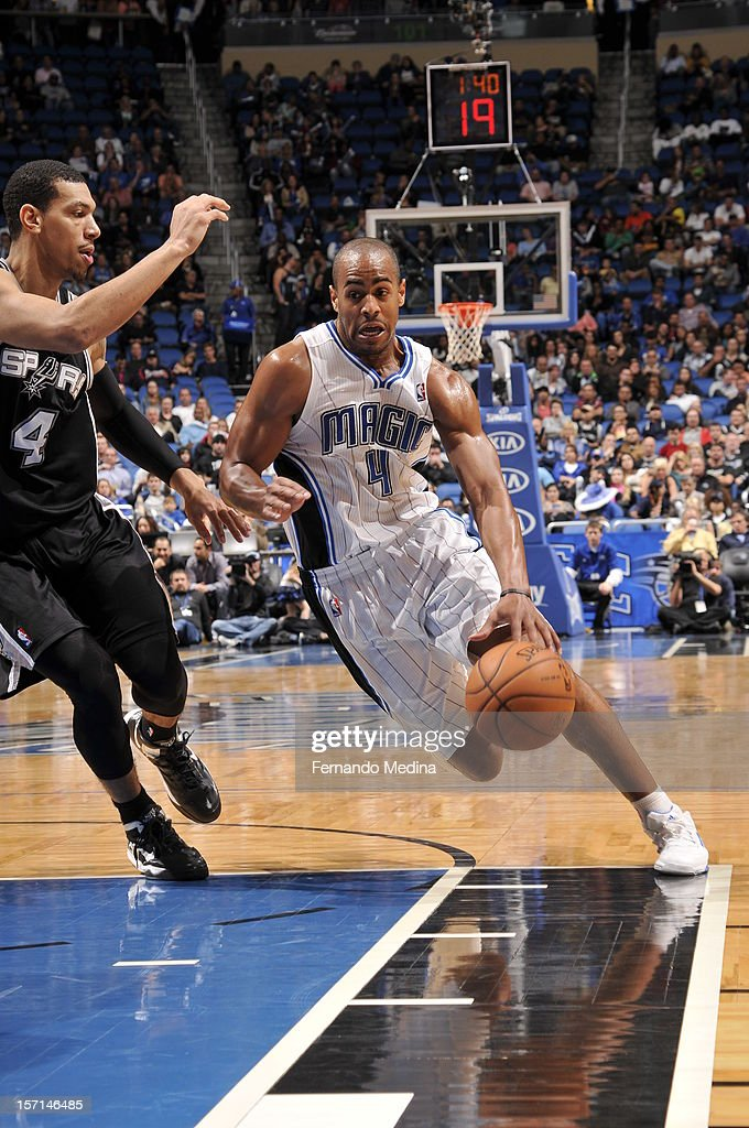 Arron Afflalo #4 of the Orlando Magic drives against Danny Green #4 of the San Antonio Spurs during the game between the San Antonio Spurs and the Orlando Magic on November 28, 2012 at Amway Center in Orlando, Florida.