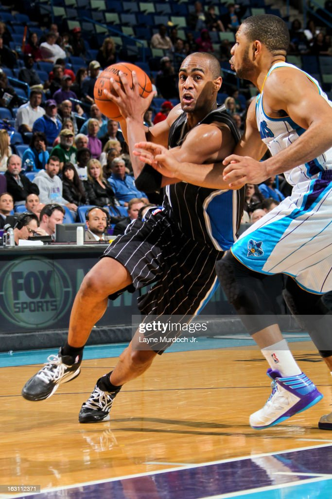 <a gi-track='captionPersonalityLinkClicked' href=/galleries/search?phrase=Arron+Afflalo&family=editorial&specificpeople=640861 ng-click='$event.stopPropagation()'>Arron Afflalo</a> #4 of the Orlando Magic drives against <a gi-track='captionPersonalityLinkClicked' href=/galleries/search?phrase=Eric+Gordon&family=editorial&specificpeople=4212733 ng-click='$event.stopPropagation()'>Eric Gordon</a> #10 of the New Orleans Hornets on March 4, 2013 at the New Orleans Arena in New Orleans, Louisiana.