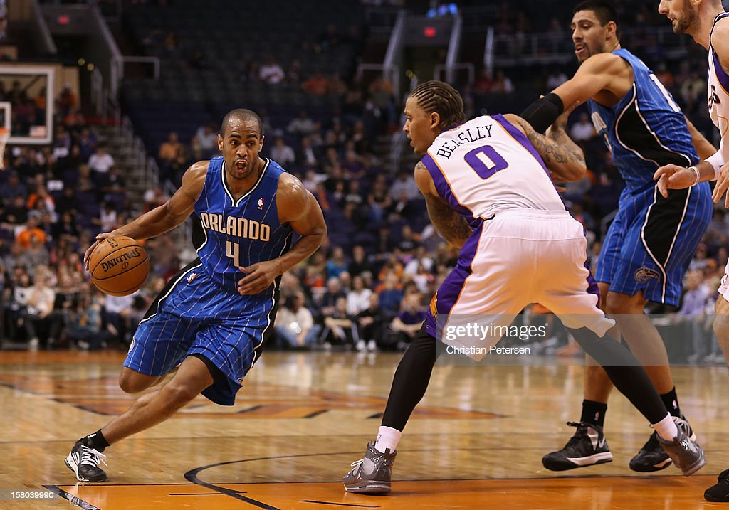 Arron Afflalo #4 of the Orlando Magic drives the ball past Michael Beasley #0 of the Phoenix Suns during the NBA game at US Airways Center on December 9, 2012 in Phoenix, Arizona.