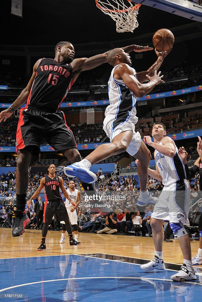 <a gi-track='captionPersonalityLinkClicked' href=/galleries/search?phrase=Arron+Afflalo&family=editorial&specificpeople=640861 ng-click='$event.stopPropagation()'>Arron Afflalo</a> #4 of the Orlando Magic drives to the basket against <a gi-track='captionPersonalityLinkClicked' href=/galleries/search?phrase=Amir+Johnson&family=editorial&specificpeople=556786 ng-click='$event.stopPropagation()'>Amir Johnson</a> #15 of the Toronoto Raptors during a game on January 24, 2013 at Amway Center in Orlando, Florida.