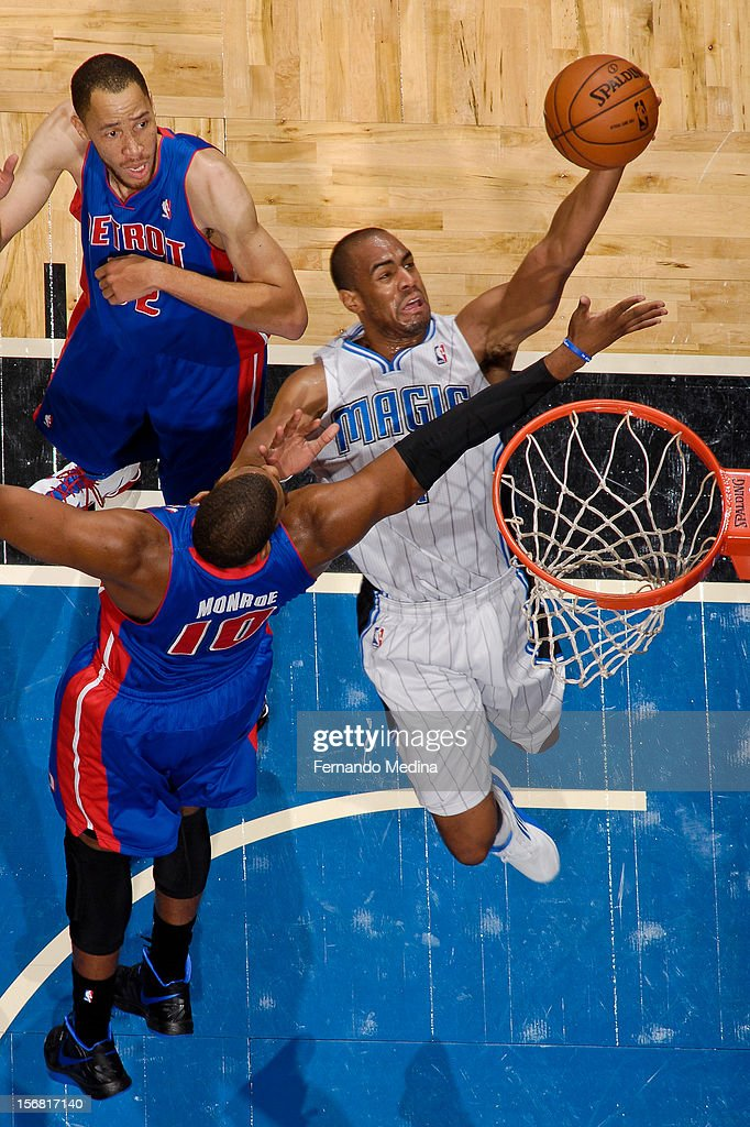 Arron Afflalo #4 of the Orlando Magic drives to the basket against Greg Monroe #10 of the Detroit Pistons on November 21, 2012 at Amway Center in Orlando, Florida.