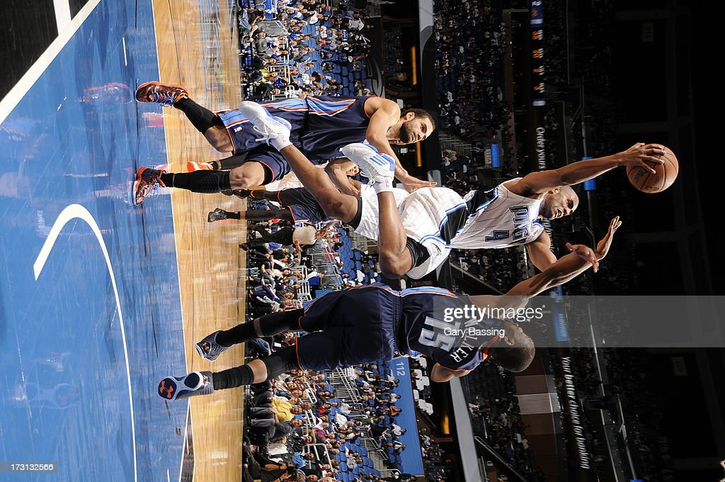 <a gi-track='captionPersonalityLinkClicked' href=/galleries/search?phrase=Arron+Afflalo&family=editorial&specificpeople=640861 ng-click='$event.stopPropagation()'>Arron Afflalo</a> #4 of the Orlando Magic drives to the basket against <a gi-track='captionPersonalityLinkClicked' href=/galleries/search?phrase=Kemba+Walker&family=editorial&specificpeople=5042442 ng-click='$event.stopPropagation()'>Kemba Walker</a> #15 of the Charlotte Bobcats during a game on January 18, 2013 at Amway Center in Orlando, Florida.