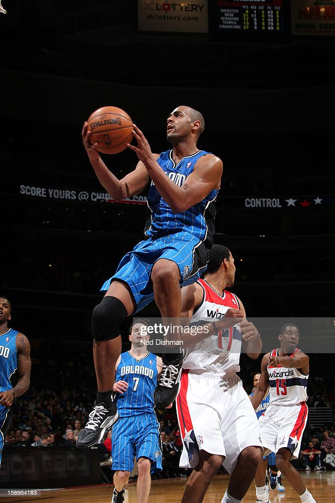 <a gi-track='captionPersonalityLinkClicked' href=/galleries/search?phrase=Arron+Afflalo&family=editorial&specificpeople=640861 ng-click='$event.stopPropagation()'>Arron Afflalo</a> #4 of the Orlando Magic drives to the basket against the Washington Wizards at the Verizon Center on December 28, 2012 in Washington, DC.