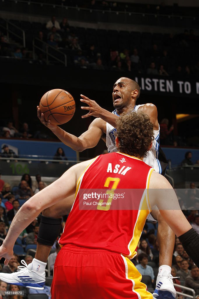 Arron Afflalo #4 of the Orlando Magic drives to the basket against the Houston Rockets on March 1, 2013 at Amway Center in Orlando, Florida.